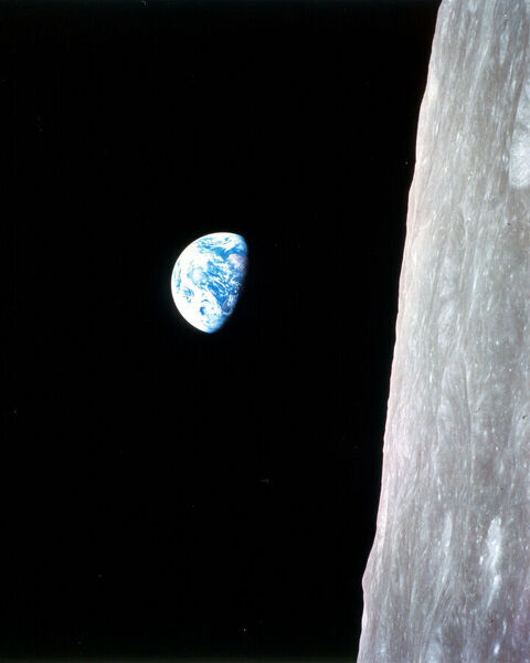 This view of the rising Earth greeted the Apollo 8 astronauts as they came from behind the Moon after the lunar orbit insertion burn