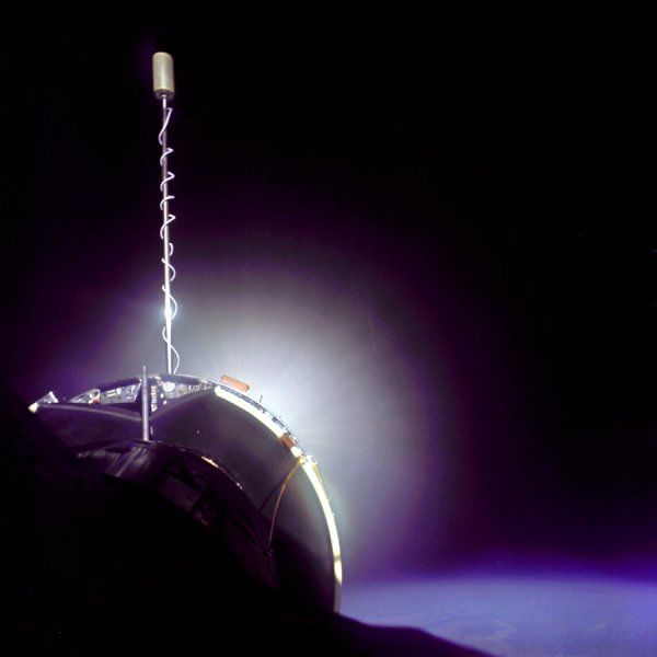The Gemini 10 spacecraft is successfully docked with the Agena Target Vehicle. The Agena display panel is clearly visible as is glow from Agena's primary propulsion system