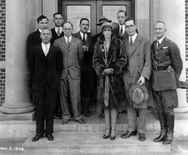 Group photo on steps of Langley Research Building in 1928. front row, left to right: E.A. Meyers, Elton Miller, Amelia Earhart, Henry Reid, and Lt. Col. Jacob W.S. Wuest. Back row, left to right: Carlton Kemper, Raymond Sharp, Thomas Carroll