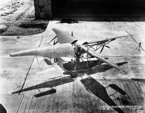 In June of 1930 this Curtiss Bleeker Helicopter was photographed on the tarmac in front of the Langley hangar. The first successful helicopters, however, appeared in Europe later in the decade