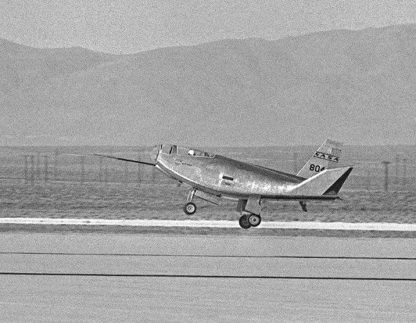 With pilot Bruce Peterson at the controls, the HL-10 lifting body aircraft makes a successful landing on Rogers Dry Lake at the Dryden Flight Research Center at Edwards, California