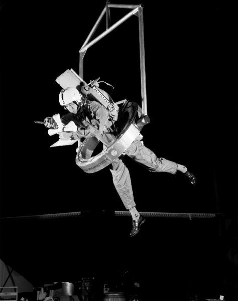 OMEGA (One-Man Extravehicular Gimbal Arrangement) shown here permits unlimited freedom, and was designed around a parallel pair of 32-inch-diameter thin-line angular-contact bearings with half the balls removed to minimize friction